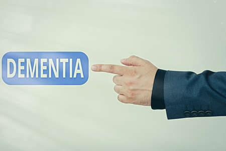 Text sign showing Dementia. Business photo text usually, a progressive condition marked by multiple deficits Model with pointing hand finger symbolizing navigation progress growth