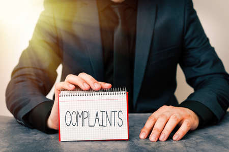 Conceptual hand writing showing Complaints. Concept meaning something that is the cause or subject of protest or outcry Model displaying different color notepad mock-up for writing idea Stock Photo