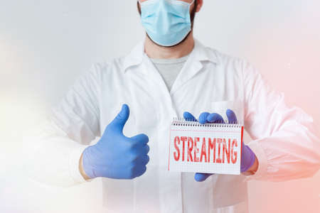 Conceptual hand writing showing Streaming. Concept meaning process, or an instance of streaming data or accessing data Laboratory Technician Featuring Sticker Paper Smartphone