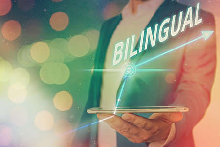 Word writing text Bilingual. Business photo showcasing using or able to use two languages especially with equal fluency Arrow symbol going upward denoting points showing significant achievement