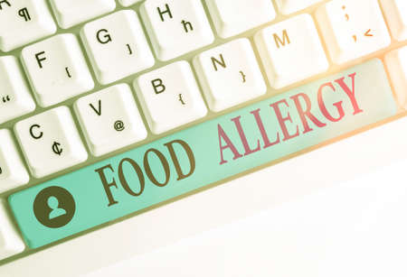 Writing note showing Food Allergy. Business concept for abnormal immune system response to allergen after eaten Colored keyboard key with accessories arranged on empty copy space Stock Photo