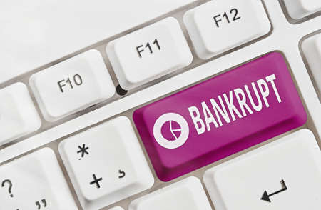 Text sign showing Bankrupt. Business photo text reduced to a state of financial ruin or exhausted of something Different colored keyboard key with accessories arranged on empty copy space Stock Photo