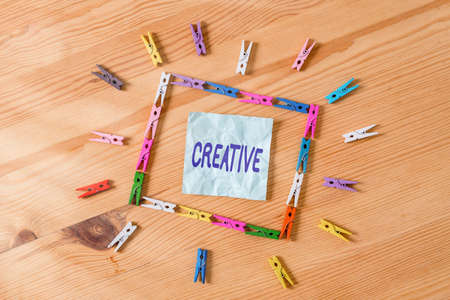 Handwriting text Creative. Conceptual photo managed to get around legal or conventional limits of laws Colored clothespin papers empty reminder wooden floor background office