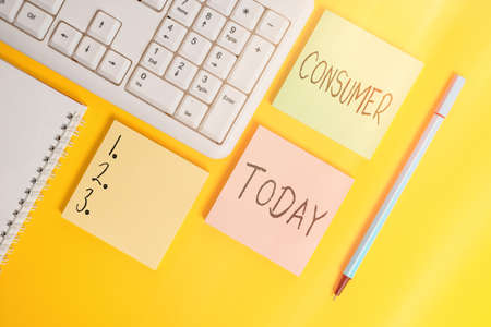 Conceptual hand writing showing Consumer. Concept meaning one that utilizes economic goods that are sold by manufacturers Empty papers with copy space on yellow background table