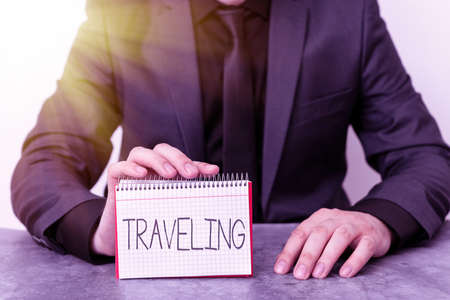 Conceptual hand writing showing Traveling. Concept meaning going to different places instead of staying in one place Model displaying different color notepad mock-up for writing idea 写真素材