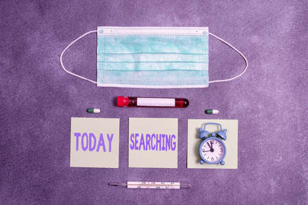 Handwriting text writing Searching. Conceptual photo look into or over carefully or thoroughly in an effort to find Extracted blood sample vial with medical accessories ready for examination