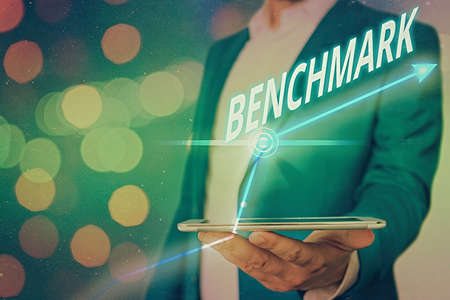 Word writing text Benchmark. Business photo showcasing something that serves as a standard by which others may be measured Arrow symbol going upward denoting points showing significant achievement Foto de archivo