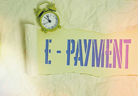 Handwriting text writing E Payment. Conceptual photo paying for goods or services on the internet E meaning electronic Rolled ripped torn cardboard placed above a wooden classic table backdrop Foto de archivo