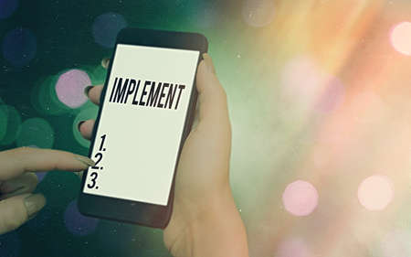 Conceptual hand writing showing Implement. Concept meaning to provide instruments or means of expression for something Modern gadgets white screen under colorful bokeh background