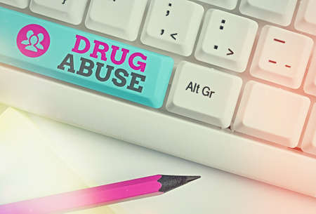 Word writing text Drug Abuse. Business photo showcasing the habitual taking of use of prescription or illegal drugs Different colored keyboard key with accessories arranged on empty copy space Banque d'images
