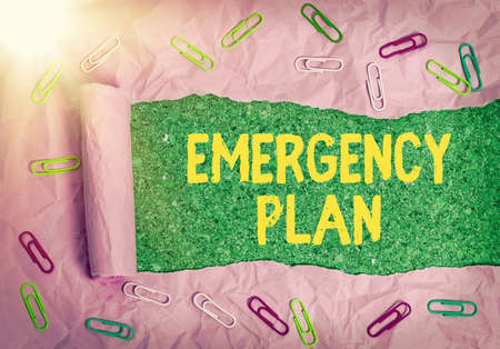 Word writing text Emergency Plan. Business photo showcasing actions to be conducted in a certain order or manner Rolled ripped torn cardboard placed above a wooden classic table backdrop