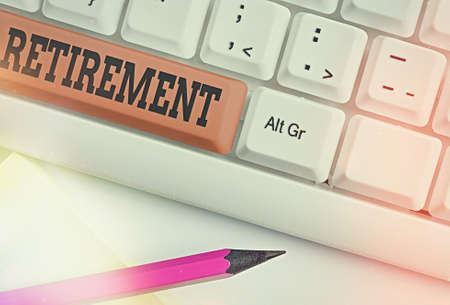 Text sign showing Retirement. Business photo showcasing withdrawal from one s is occupation or from active working life Different colored keyboard key with accessories arranged on empty copy space