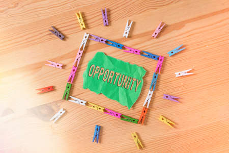 Conceptual hand writing showing Opportunity. Concept meaning set of circumstances that makes it possible to do something Colored crumpled papers wooden floor background clothespin Imagens