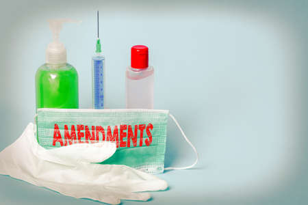 Handwriting text writing Amendments. Conceptual photo process of amending a law or document by parliamentary. Primary medical precautionary equipments for health care protection