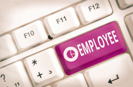 Text sign showing Employee. Business photo text one employed by another usually for wages or salary below the executive Different colored keyboard key with accessories arranged on empty copy space