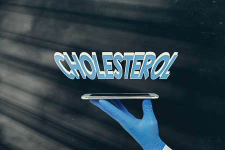 Writing note showing Cholesterol. Business concept for compound of the sterol type found in most body tissues Displaying Sticker Paper Accessories With Medical Gloves On