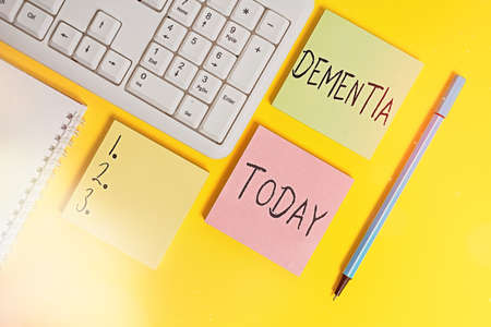 Conceptual hand writing showing Dementia. Concept meaning usually, a progressive condition marked by multiple deficits Empty papers with copy space on yellow background table