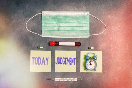 Handwriting text writing Judgement. Conceptual photo process of forming an evaluation by discerning and comparing Extracted blood sample vial with medical accessories ready for examination Imagens