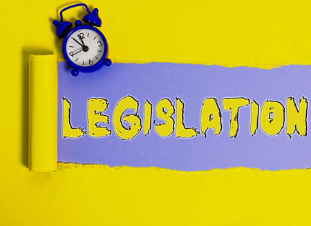 Word writing text Legislation. Business photo showcasing the exercise of the power and function of making rules Rolled ripped torn cardboard placed above a wooden classic table backdrop