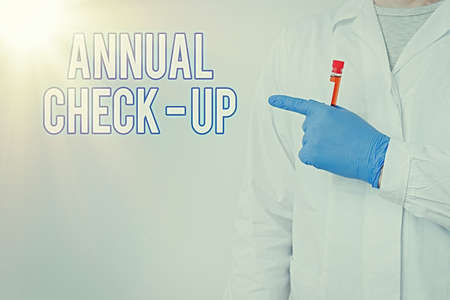 Writing note showing Annual Checkup. Business concept for yearly reproductive health visit with a health care provider Laboratory Blood Test Sample Shown For Medical Diagnostic