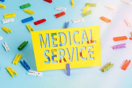 Text sign showing Medical Service. Business photo text care and treatment provided by a licensed medical provider Colored clothespin papers empty reminder blue floor background office pin