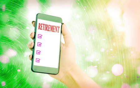 Handwriting text writing Retirement. Conceptual photo withdrawal from one s is occupation or from active working life Modern gadgets with white display screen under colorful bokeh background