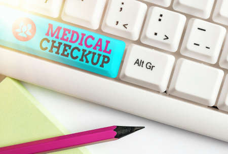 Word writing text Medical Checkup. Business photo showcasing the examination carried out to determine the physical fitness Different colored keyboard key with accessories arranged on empty copy space 版權商用圖片