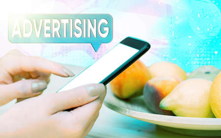 Word writing text Advertising. Business photo showcasing action of calling attention of the public by paid announcements Modern gadgets with white display screen under colorful bokeh background