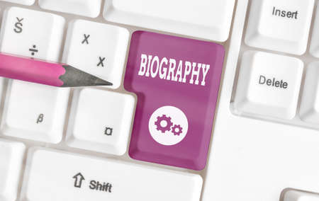 Writing note showing Biography. Business concept for an account of the life of something such as an animal, a coin, etc. Colored keyboard key with accessories arranged on empty copy space