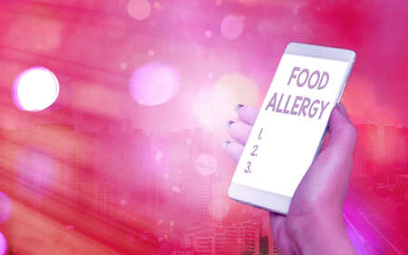 Word writing text Food Allergy. Business photo showcasing abnormal immune system response to allergen after eaten Modern gadgets with white display screen under colorful bokeh background