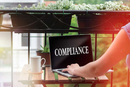 Word writing text Compliance. Business photo showcasing ability of an object to yield elastically when a force is applied Personal workplace overview with laptop device used for individual interest