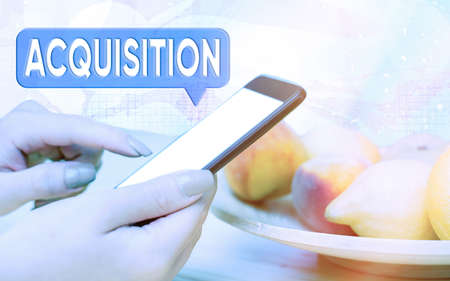 Word writing text Acquisition. Business photo showcasing asset or object bought or obtained, typically by a library Modern gadgets with white display screen under colorful bokeh background Stock fotó