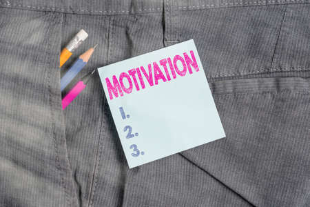 Handwriting text Motivation. Conceptual photo the general desire or willingness of someone to do something Writing equipment and blue note paper inside pocket of man work trousers