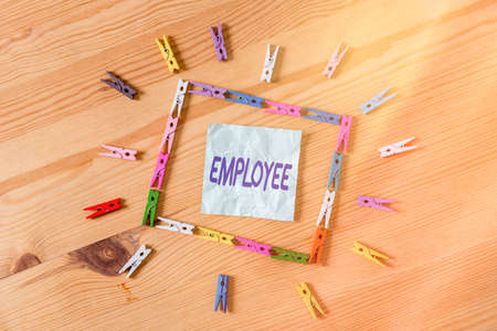 Handwriting text Employee. Conceptual photo one employed by another usually for wages or salary below the executive Colored clothespin papers empty reminder wooden floor background office