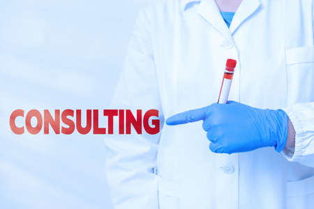 Handwriting text writing Consulting. Conceptual photo business of giving expert advice typically in business matters Laboratory blood test sample shown for medical diagnostic analysis result