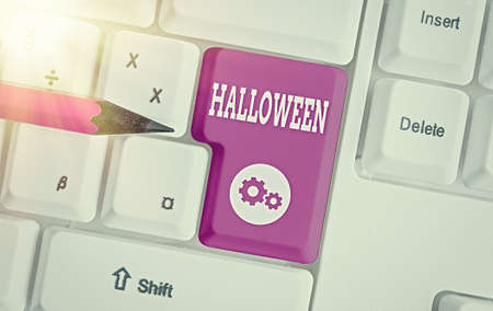 Writing note showing Halloween. Business concept for October 31 observed especially with dressing up in disguise Colored keyboard key with accessories arranged on empty copy space