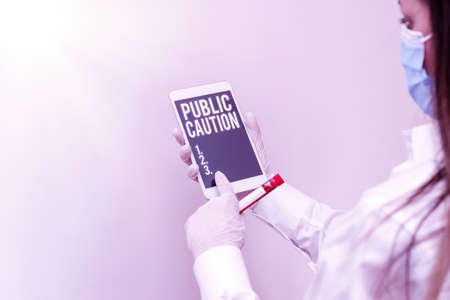 Text sign showing Public Caution. Business photo showcasing formal warning given to the public to express a potential risk Extracted blood sample vial with lastest technology ready for examination