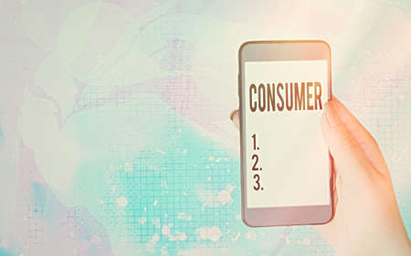 Word writing text Consumer. Business photo showcasing one that utilizes economic goods that are sold by manufacturers Modern gadgets with white display screen under colorful bokeh background