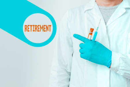 Text sign showing Retirement. Business photo showcasing withdrawal from one s is occupation or from active working life Displaying Empty Sticker Paper Accessories Smartphone With Medical Gloves On Reklamní fotografie
