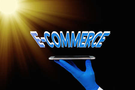 Writing note showing E Commerce. Business concept for use electronic transmission medium for buying, selling of product Displaying Sticker Paper Accessories With Medical Gloves On Stock Photo