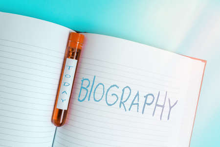 Writing note showing Biography. Business concept for an account of the life of something such as an animal, a coin, etc. Blood sample vial medical accessories ready for examination