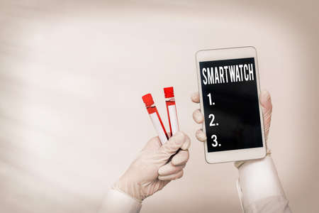 Handwriting text writing Smartwatch. Conceptual photo mobile device with touchscreen display, to be worn on the wrist Extracted blood sample vial with lastest technology ready for examination