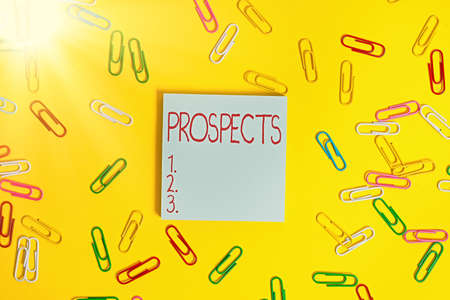 Writing note showing Prospects. Business concept for potential buyer or customer, candidate for a job position Flat lay above empty paper with copy space and colored paper clips Archivio Fotografico