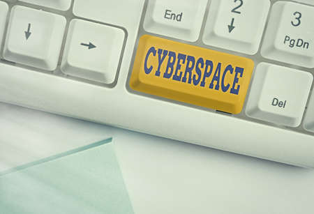 Text sign showing Cyberspace. Business photo text the online world of computer networks and especially the Internet Different colored keyboard key with accessories arranged on empty copy space