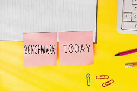 Word writing text Benchmark. Business photo showcasing something that serves as a standard by which others may be measured Flat lay above table with blank papers with copy space for text messages