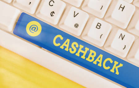 Writing note showing Cashback. Business concept for actual cash that can be applied to a credit card bill and received Colored keyboard key with accessories arranged on empty copy space