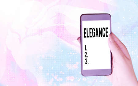 Word writing text Elegance. Business photo showcasing scientific precision, neatness, and simplicity of something Modern gadgets with white display screen under colorful bokeh background