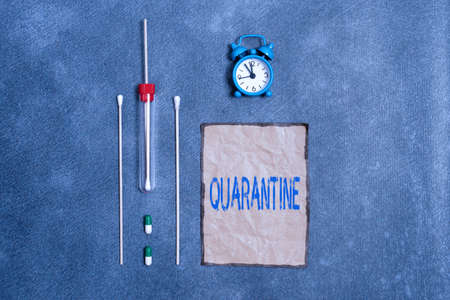 Conceptual hand writing showing Quarantine. Concept meaning restraint upon the activities of an individual or the transport of goods Set of medical equipment for health condition assessment
