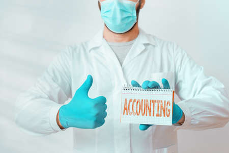 Conceptual hand writing showing Accounting. Concept meaning system of summarizing business and financial transactions Laboratory Technician Featuring Sticker Paper Smartphone Archivio Fotografico