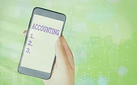 Writing note showing Accounting. Business concept for system of summarizing business and financial transactions Modern gadgets white screen under colorful bokeh background